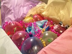 Birthday party in a box! The box is filled with party supplies including party hats, noise makers, crepe paper, birthday banner, plates and napkins and birthday number candle complete with birthday cake(Hostess cupcakes). All that is topped with balloons with with dollar bills, special notes from the family, and confetti.  A few ribbon curly-cues and it's off in the mail! Fun!