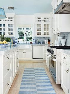 "Shades of blue and white make for a cheerful, crisp kitchen. ""I love blue-and-white dhurries,"" Mark says. ""My new collection for Merida is inspired by many of these antique Indian textiles."" Inside the personal home of Mark Sikes kitchen Blue Kitchens, Country Kitchen Farmhouse, Kitchen Colors, Kitchen Remodel, Hamptons Kitchen, Blue Ceilings, Kitchen Redo, Kitchen Renovation, Kitchen Design"