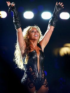 Beyoncé stands victorious after her amazing Super Bowl halftime performance, which included an appearance by Destiny's Child.