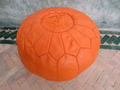 Bright orange pouf