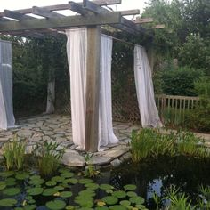Showing homes today: Backyard Oasis in the middle of suburban Suffolk. Man-made pond full of Koi, and a DIY pergola with sheer panels. It was beautiful!