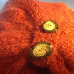 Knit cowl with buttons of willow twigs
