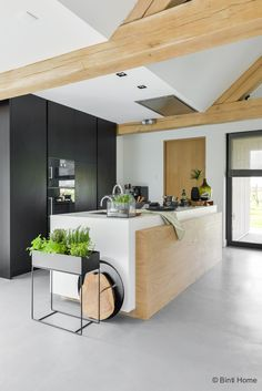 Grey white and light wood kitchen