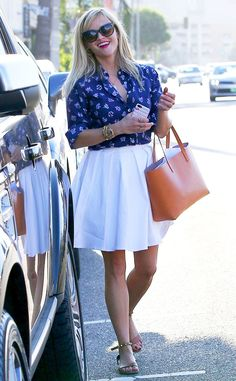 Into the Blue from Reese Witherspoon's Street Style  Reese is all smiles in a flowing white skirt and royal blue top.