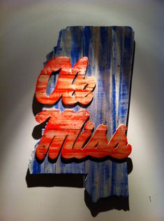 Wooden State of Mississippi with Ole Miss logo on Etsy, $110.00  Would look just as cute with SMTTT or Hail State!
