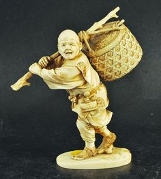 A GOOD SIGNED 19TH CENTURY JAPANESE MEIJI PERIOD CARVED IVORY OKIMONO OF A FARMER, carrying a large basket over his shoulder, the basket tied to a long stick, the robes of the farmer with engraved and stained decoration, the base with a signature, 6.1in high.