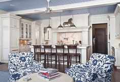 Enlarge your space with sky-blue ceilings. Blue ceilings are often found on porches, but why not give them a try indoors? A blue ceiling in the kitchen will make you feel like you are cooking in the open air, increasing the sense of space. Blue Ceilings, Blue Kitchens, Interior Design, White Kitchen Design, Beadboard Ceiling, Home, White Ceiling, White Decor, Home Decor