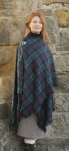 Tartan shawl cape with thistle pin.