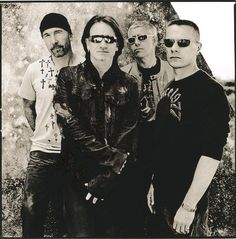 Music: U2. An Irish rock band from Dublin. Formed in 1976, the group consists of Bono, The Edge, Adam Clayton, and Larry Mullen, Jr.