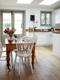 shrimper's cottage kitchen- love the grey door and window.