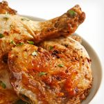 In a small bowl, mix oil and spices. Rub chicken legs with spice mixture; arrange on a baking sheet. Refrigerate 30