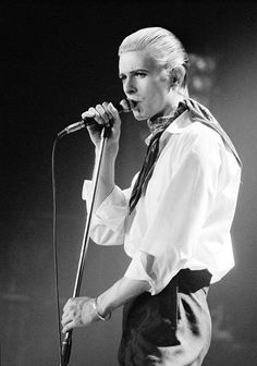 April 29, 1976 - The Thin White Duke as a swashbuckler, with scarf and full, flowing shirt, during a 1976 show in Copenhagen