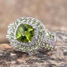 Hebei Peridot and White Topaz Ring in Platinum Over Sterling Silver