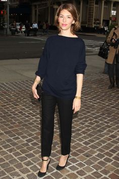 Sofia coppola in miniml black and blue. Love the dressy trousers & sweater combo.