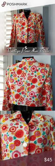 "VERTIGO France Floral Cropped Blazer Jacket Made in Paris, France.   Unsure if jacket is new due to great condition, but I'm tagging this as ""preowned"" just to be safe.   No signs if wear.  Lovely colorful cropped waist high blazer, jacket.   Lovely Large creme metallic buttons 100% cotton Soft Interior lining  Size SMALL  Breast 36"" Waist 32"" Arm length 23"" Length 19""  Stop by my closet for more great fashion deals vertigo pour la ville paris Jackets & Coats Blazers"