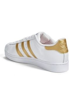 2016 will go on record for several fashion trends and one of the most popular is white and gold womens shoes. It seems white and gold women's shoes are wildly popular      adidas Originals Women's Superstar W Fashion Sneaker, Clear Onix/Clear Onix/White, 8.5 M US