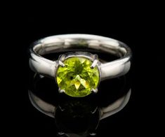 Beautiful Peridot ring in sterling silver, Will make a great Peridot engagement ring or an August birthstone ring. Peridot has an amazing lime green color that is so unique. No wonder it is such a loved gemstone. This ring is a great engagement ring if you want something a bit
