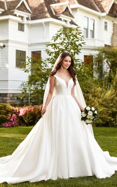 A simple style that radiates elegant romance, this off-the-shoulder wedding gown from Martina Liana is perfect for the modern, traditional bride.