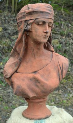 Female Bust Arabian a beautiful bust of a young woman with a scarf covering her head hand cast in frost proof reconstituted stone with an aged