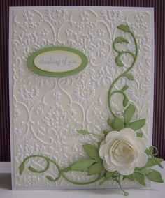 "Stamp:  On the Grow - sentiment (SU!)  Paper:  Whisper White, Certainly Celery (SU!)  Ink:  Barely Banana, Certainly Celery (SU!)  Accessories & Tools:  Cuttlebug ""Textiles"" embossing folder, rubber brayer, Big shot, Rolled Rose die-cut (C.C. Designs), Leaves die-cut (C.C. Designs), Savannah border die-cut (Memory Box), Madera corner die-cut (Memory Box), sponge, small oval punch, medium oval punch"