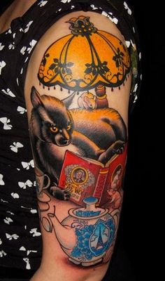 Cute coloured funny cat tattoo on shoulder