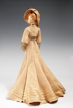 """""""1902 Doll"""" Designer: Robert Piguet (French, born Switzerland, 1901–1953) Paulette (French) Vedrenne (French) Fernand Aubry (French) Date: 1949 Culture: French Medium: metal, plaster, hair, silk, straw, cotton, feather, wood. Back"""