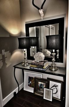 Black and White Decor Entryway Mirror  Love the idea of the artwork under the table and the overall design.
