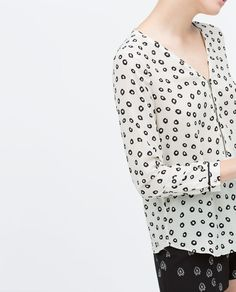 PIPED LONG SLEEVE PRINTED TOP WITH FRONT ZIP from Zara