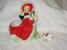 Vintage Christmas Red Dress Napco Ceramic Shopper Girl Planter With Poodle 1950's Japan Spaghetti trim 7 Inches Tall. $115.00, via Etsy.