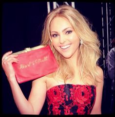 The GORGEOUS AnnaSophia Robb rocking her 'Heart + Truth' clutch backstage at The Heart Truth Fashion Show #gored #thecarriediaries #wearredday www.ComesWithBaggage.com