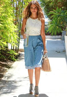 Trending Fashion Style: High-waisted Skirt. -Jessica Alba in white floral sleeveless top + high-waist denim skirt + peep-toe denim booties street style Santa Monica August 2014.