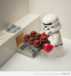 a Lego Storm Trooper making cupcakes