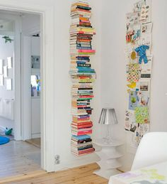Books on floating shelves stacked all the way up a wall