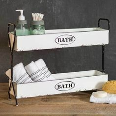 Bring the vintage farmhouse decor look to your bathroom with this Enamel 2 Tier Bath Storage Caddy. Stay organized with the two bins with the word BATH being featuring on each tier. This enamelware-look finish will brighten any space. Bathroom Caddy, Bathroom Organisation, Bath Caddy, Bathroom Ideas, Organized Bathroom, Bathroom Cabinets, Organization, Bathroom Makeovers, Bathroom Bath