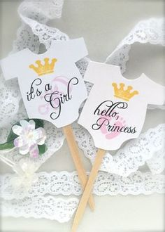 Set of 10 cupcake toppers for girl baby shower, very cute.   They are double sided so they look great from and back.   They have the its a girl printed on the front and hello, princess printed on the back   They are attached to wooden picks(as shown in photos) They are made to order.   The cupcake toppers measure 2 and the total height is aprox. 4.   They are printed on white heavy card stock - 110 lb.   They are sold in sets of 10; if you need different quantities please feel free to send…