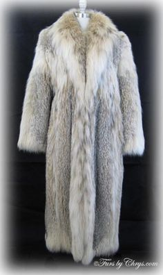 Ankle Length Lynx Coat #L762; $3500.00; Excellent Condition; Size range: 8 - 12. This is a spectacular genuine lynx fur coat in the ultra-glamorous ankle length and in pristine condition. It features a stunning and luxuriously large shawl collar. This lynx fur is so unbelievably silky soft and very full and fluffy; you won't want to take it off! When you wear it, you will feel regal and it will be your favorite addition to your winter wardrobe!