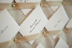 Linen & pearl pin escort card board...really neat idea, and probably really easy to DIY