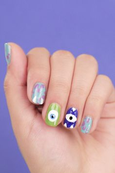 Head to Monstropolis with this colorful Monsters, Inc. inspired nail art. | Mike Wazowski + Sulley Pixar manicure | [ http://di.sn/60088Eq9I ]