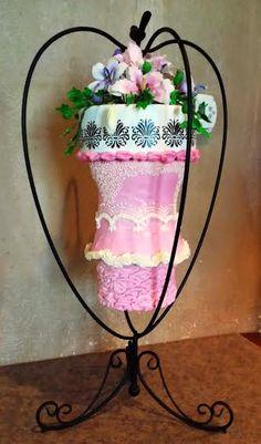 Hanging Chandelier Cake www.cakestackers.com Chandelier Cake, Hanging Chandelier, Cake Pictures, Plant Hanger, Florals, Cakes, Wedding Dresses, Jewelry, Home Decor