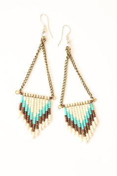 We are hooked to these beaded earrings. #light #accessories #summer #blue #cream #copper #beads.