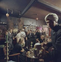 A man in a turban serves a platter of drinks to diners at the Indian House restaurant, San Francisco, California, 1956. (Photo by Nat Farbman/The LIFE Picture Collection/Getty Images) Photo: Nat Farbman/The LIFE Picture Collection