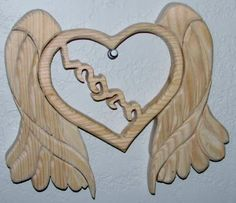 custom order for a child that has gone home to heaven.  Name in center and angel wings around it.