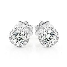 Unique Diamond Studs! These 14K Cluster Diamond Stud Earrings showcase 0.70 ctw of sparkling round diamonds, each masterfully prong or pave set in luscious 14K gold. Featuring a fabulous design and convenient push back closures, these versatile diamond stud earrings are available in 14K white, yellow and rose gold.