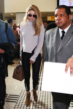 In true model off-duty style, Hadid arrived into Sao Paulo, Brazil and broke all summer fashion rules. She wore black skinny jeans and a gray turtleneck and paired the look with sensible tan accessories.