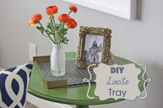 I love the look of Lucite trays! They are super classy, but run a little spendy for me.     I mean, it's just a plastic box.         So, I ...