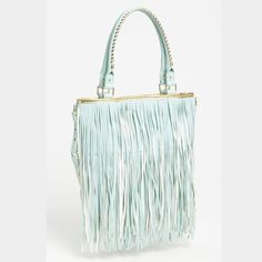 Steve Madden Cross Body Fringe Bag/Tote NEW Brand New! Rare and Gorgeous shade of mint/light blue called Cloud. The Fringe is white on one side and there are handles to carry as a bag or a strap to wear as a cross body.  This is such an unusual Pretty color for a fringe bag and Steve Madden always makes them well,! Will have more than enough space inside to carry all you need and then some! Will add pictures of original bag soon! Steve Madden Bags Crossbody Bags