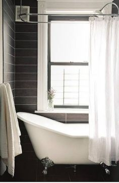 The grey tile is interesting. Not sure it works for this house, but the look of the grey on the walls with the beautiful claw foot tub is nice.