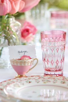 Gorgeous pink place setting with place card in teacup...