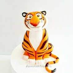 Check out this item in my Etsy shop https://www.etsy.com/listing/463475409/tiger-fondant-cake-topper-raja-cake