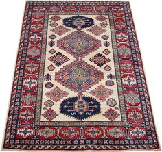 oday's Kazak is a modern shape of old Caucasian rugs which strictly adheres to traditional design elements of the Caucasus. It has elements such as the stepped hooked polygons, geometrical medallions and rosettes, presented in more stylized manner and with a new dimension.  http://www.alrug.com/4881